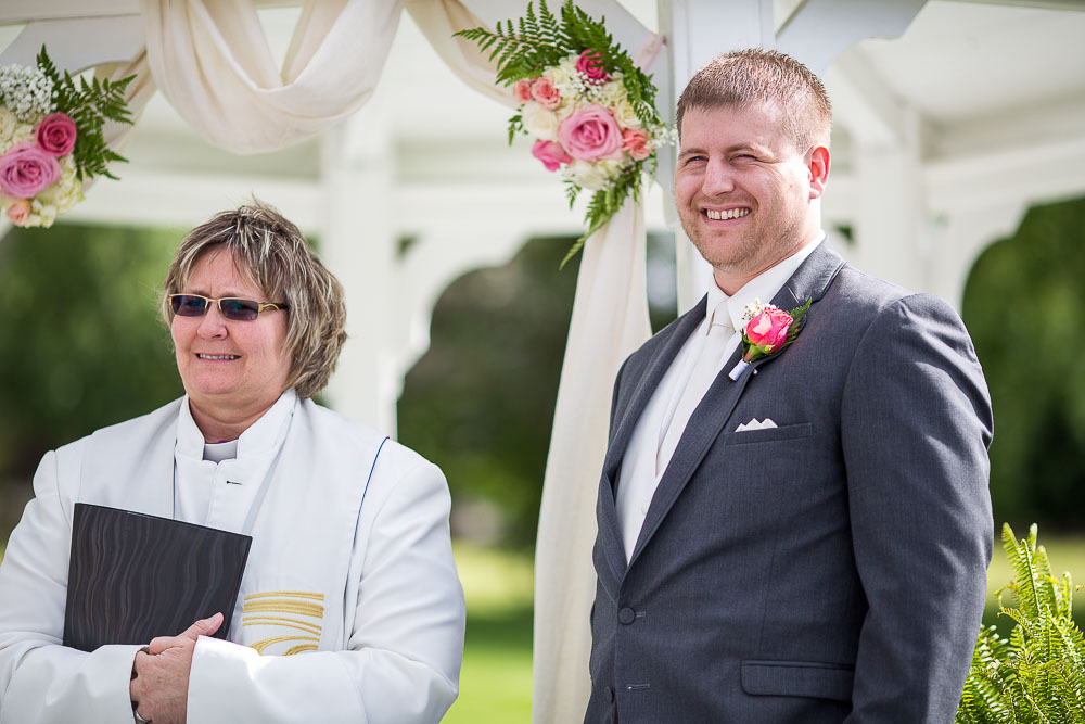 Bliss Plaza wedding photography groom smiling waiting on bride
