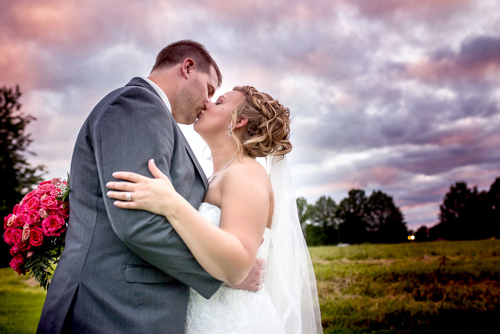 Bliss Plaza wedding photography bride and groom pose incredible shunset