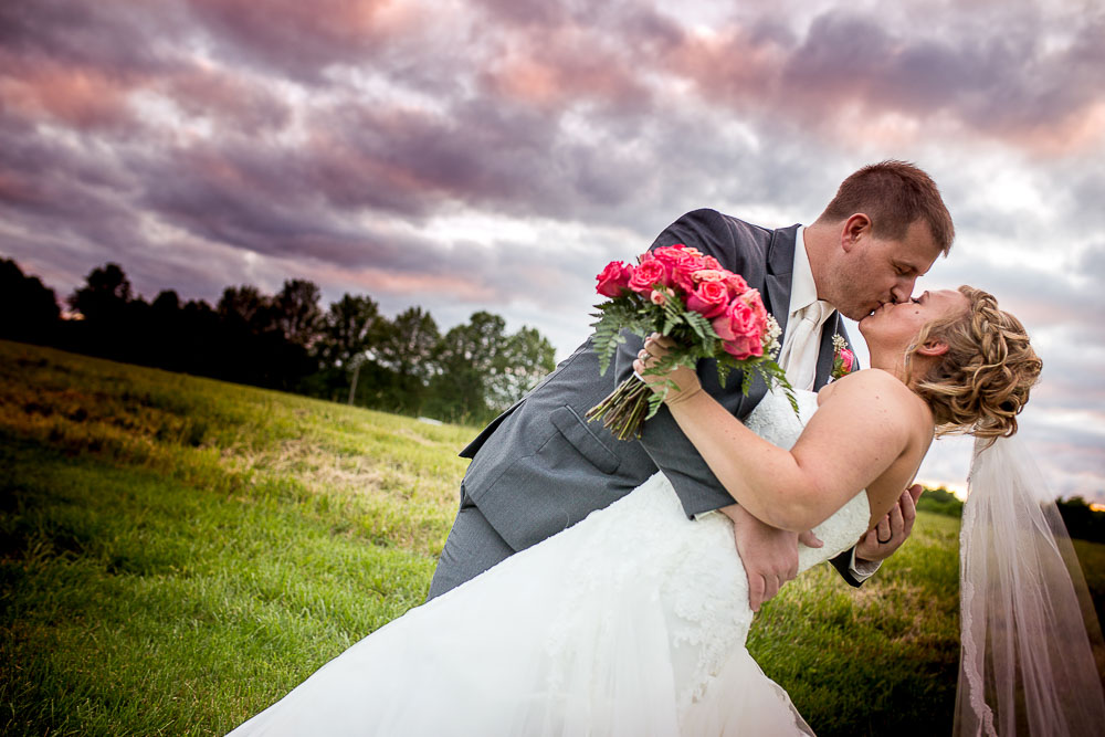Bliss Plaza wedding photography bride and groom pose incredible sunset dip