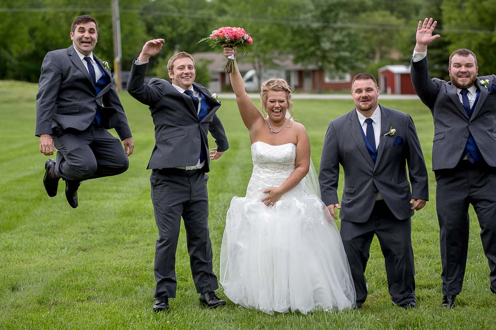 Bliss Plaza wedding photography groomsmen jumping with bride